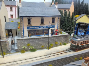Photo: 135 Another view of the village stores as a tram passes, apparently at high speed, on the tramway! Oh dear, I must keep an eye on what is happening on a layout before I press the shutter on the camera! .