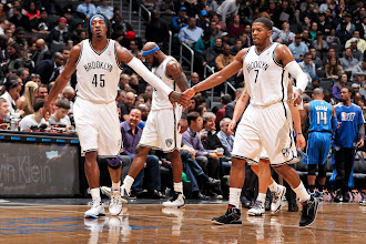 Photo: BROOKLYN, NY - JANUARY 28: Gerald Wallace #45 and Joe Johnson #7 of the Brooklyn Nets celebrate during a game against the Orlando Magic on January 28, 2013 at the Barclays Center in the Brooklyn borough of New York City.  NOTE TO USER: User expressly acknowledges and agrees that, by downloading and or using this photograph, User is consenting to the terms and conditions of the Getty Images License Agreement. Mandatory Copyright Notice: Copyright 2013 NBAE  (Photo by Nathaniel S. Butler/NBAE via Getty Images)