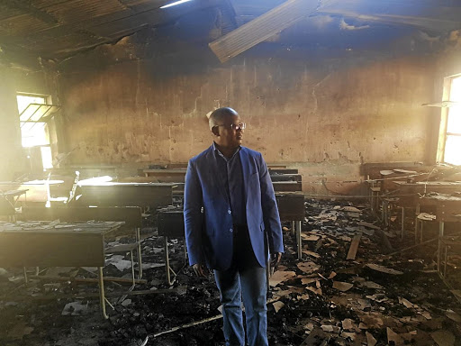 Mpumalanga MEC for education Sibusiso Malaza inspects Siyathokoza Senior Secondary School in Siyabuswa, which was allegedly torched by people unhappy with by-election results. / Mandla Khoza
