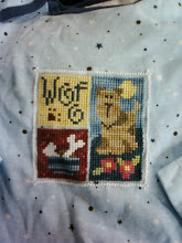 Photo: Completed 17 Jan 2010. Close-up of Woof (2004) by Lizzie*Kate. Stitched using Weeks Dye Works and The Gentle Art on a onesie.