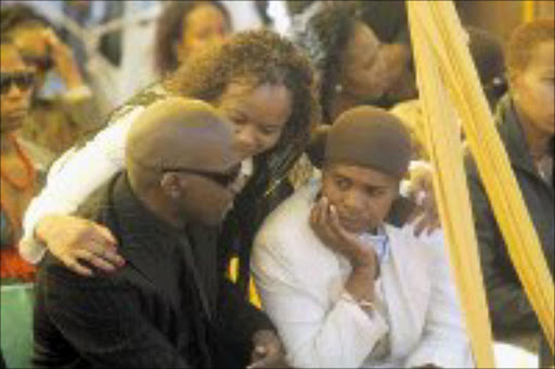 MOURNING: Mpho Tsedu comforts Dieketseng Mnisi during the funeral service for 'Doobsie'. Behind them is Gwen Ramokgopa. Pic. Veli Nhlapo. 17/05/2007. © Sowetan.