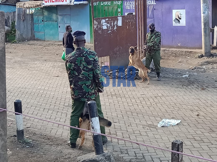 Police using dogs to barricade the gate of California Estate in Eastleigh Nairobi.Photo/Fredrick Omondi