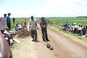 Photo: SRI rotating wheel marker in Mwea. [Photo Courtesy of Bancy Mati]