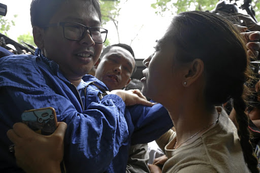 Reuters reporter Wa Lone and his wife Pan Ei Mon hug each other as he arrives at court in Yangon, Myanmar, on December 27 2017. Picture: REUTERS
