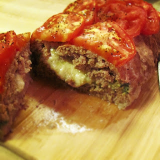 Mozzarella Stuffed Meatloaf with Roasted Tomatoes.