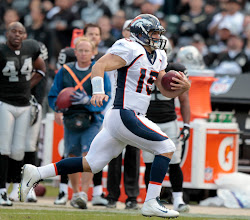 Photo: Tim Tebow takes off running, he finished with 118 rushing yards for the game. Photo by Eric Lars Bakke / Denver Broncos