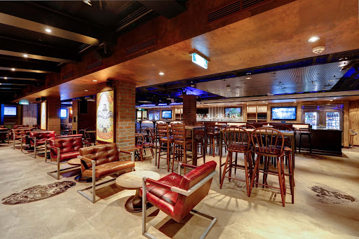 Norwegian-Escape-Brewhouse-District - After a hot day in the sun, nothing beats a cold beer! Visitors to the District Brewhouse on Norwegian Escape can choose from more than 50 bottled beers or 24 on tap.