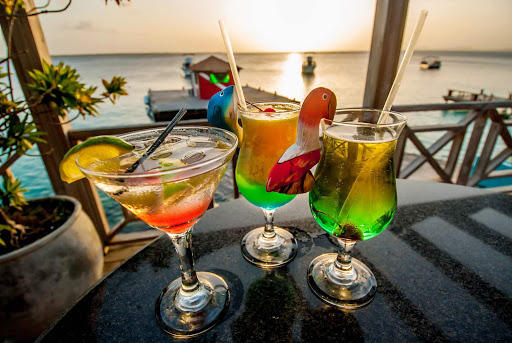 Watch the sun set with a tropical drink in Bonaire.