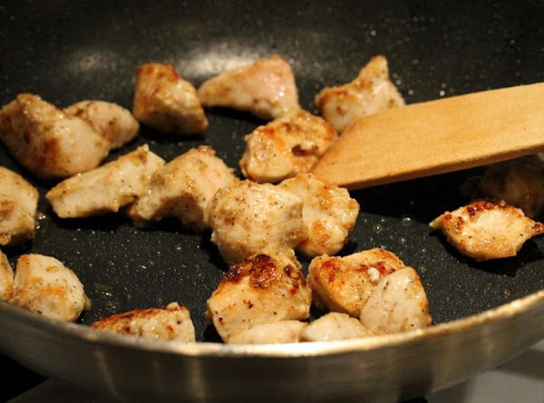Melt butter in fry pan, add cut up chicken and saute until lightly browned....