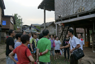Photo: Group briefing during our village homestay at Ban Natan
