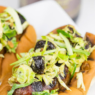 Grilled Brats with Cherry Bacon Brussels Sprout Slaw