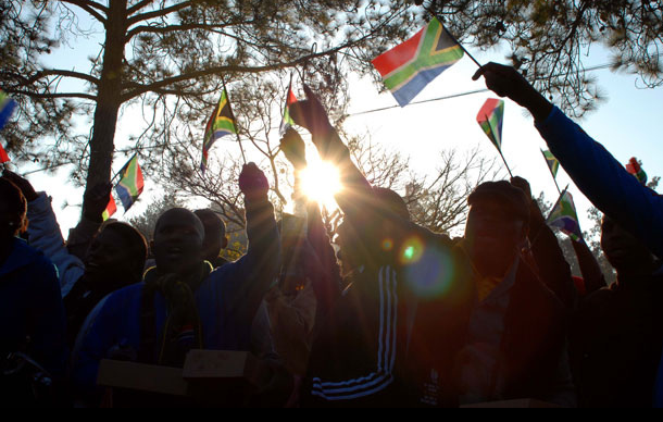 The public waves South African flags at the Union Buildings for the 2014 Presidential inauguration. Photo: GCIS