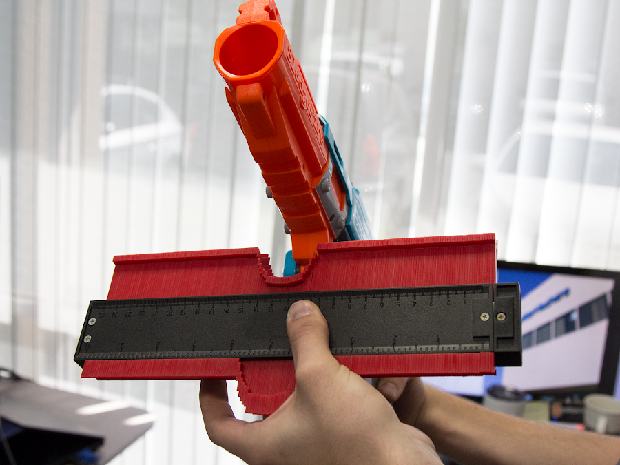 A contour gauge with the complex shape of the Sledgefire=E2=80=99s grip.