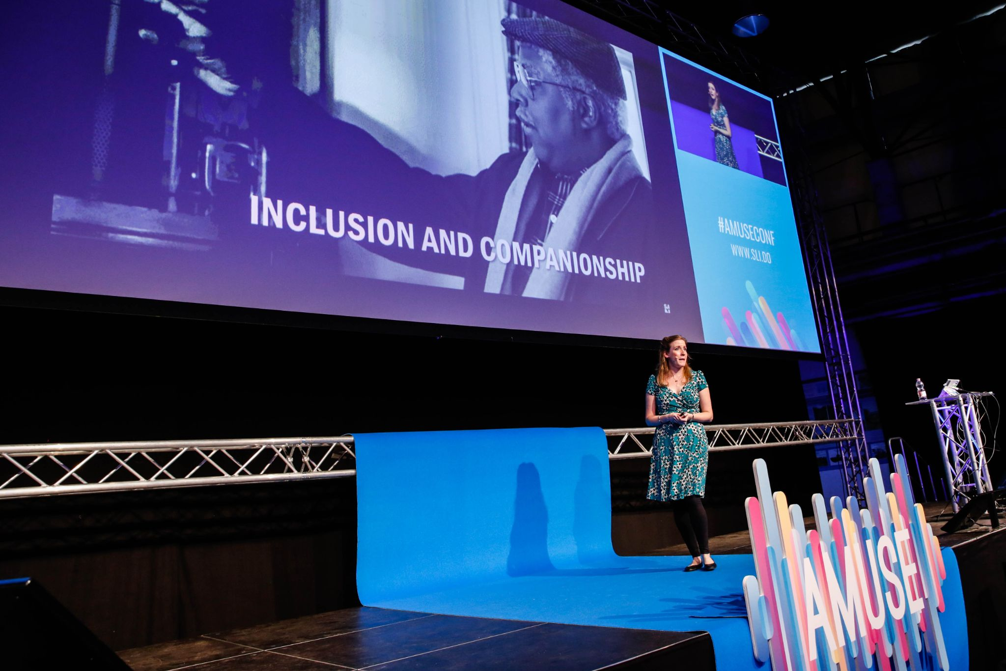 Cheryl Platz argues that multimodality maximizes inclusiveness, on stage at the 2018 Amuse UX conference.