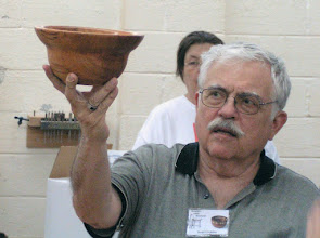 Photo: Stuart shows a bowl with a very interesting shape brought by Stan Sherman -- and in solid wood, no less!