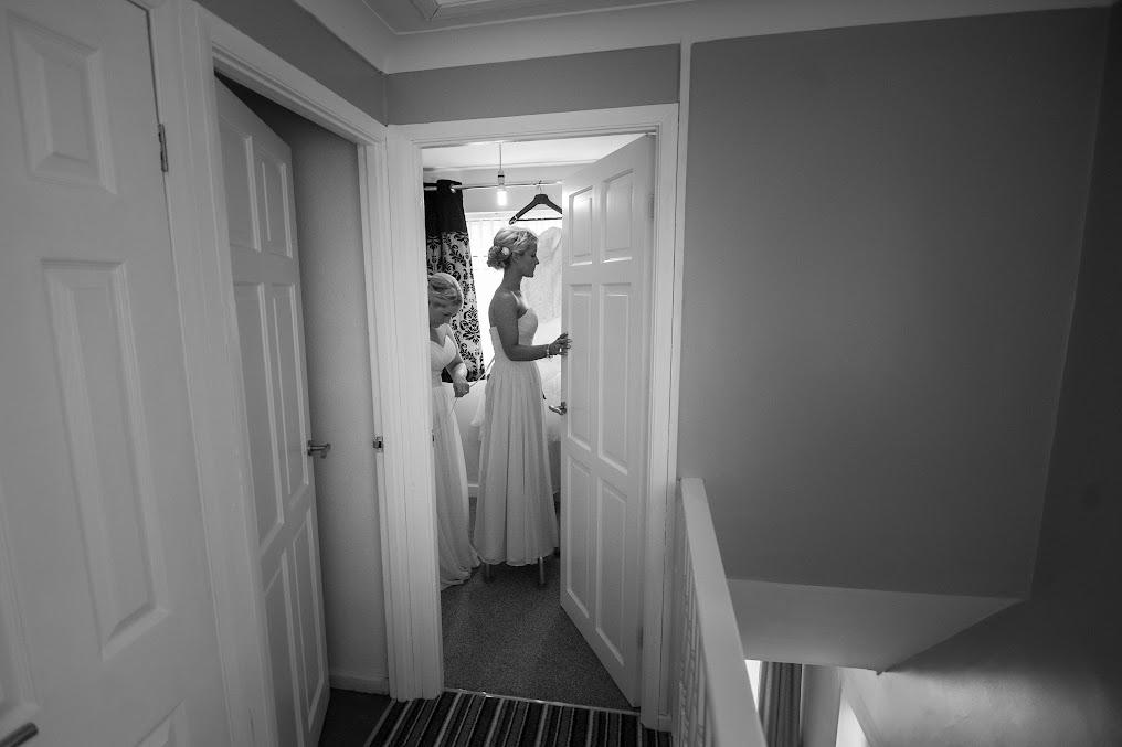bride-preparation-putting-dress