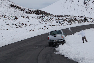 Photo: On the way down we keep seeing people shoveling snow into their trucks.