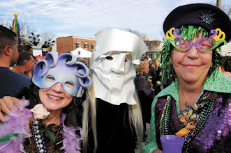 Photo: Masked Mardi Gras maidens celebrate with the crowd on Saturday at the Middle Lane Mardi Gras. (Dylan Ray photo)