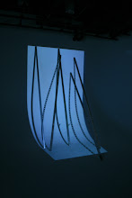 """Photo: Projection of """"Parabola,"""" 2013, hd single channel video, 17 min. trt. (loop), with scaffold, six 10' steel super studs and projector. UofC DoVA MFA critique, 03/15/13. mgf"""