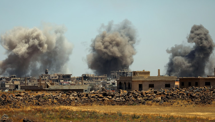 Smoke rises from al-Harak town, as seen from Deraa countryside, Syria on June 25, 2018.