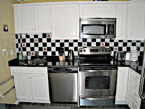 Photo: STAINLESS STEEL OVEN AND BUILT-IN MICROWAVE / HOOD COMBINATION