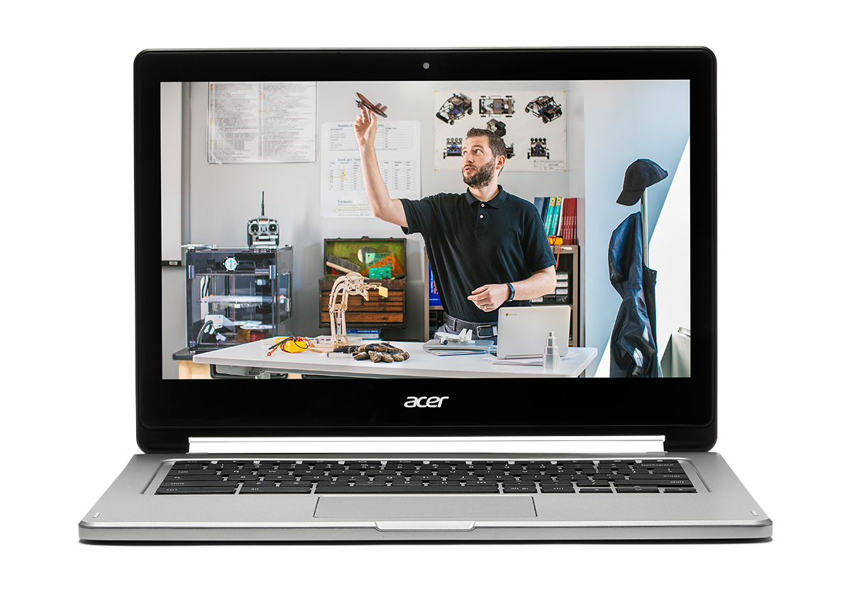 If you teach in 3D You Chromebook. Image of a Chromebook showing a teacher tossing a minature airplane at his desk.