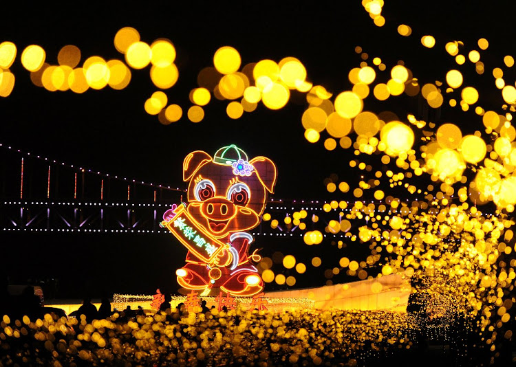 A giant pig-shaped lantern lights up ahead of the New Year and Lunar New Year celebrations at Xinghai Square in China