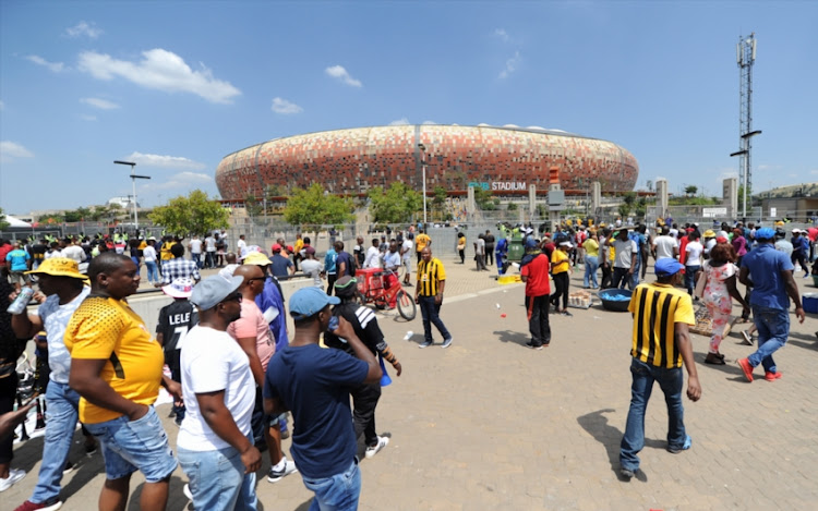 Football loving fans arriving at the stadium during the Absa Premiership match between Orlando Pirates and Kaizer Chiefs at FNB Stadium on March 03, 2018 in Johannesburg, South Africa.