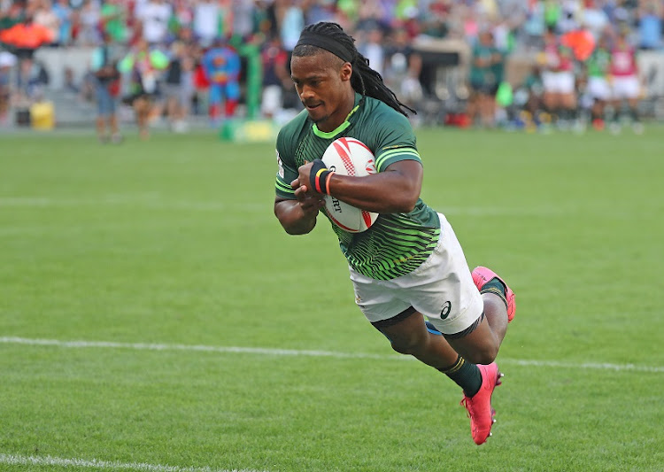 Branco du Preez of South Africa scores a try during day 2 of the 2016/17 HSBC Cape Town Sevens rugby match between South Africa and New Zealand at Cape Town Stadium.