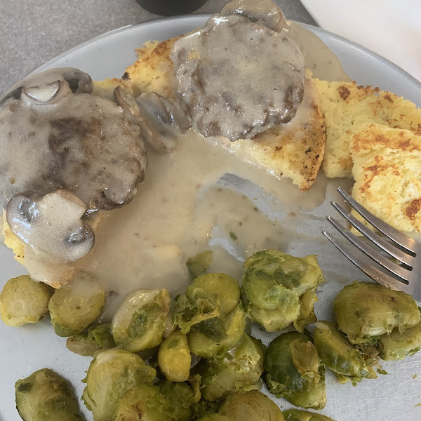 This was the lunch special for the day  Meatloaf, mushroom gravy , biscuit and Brussel sprouts  Delicious!