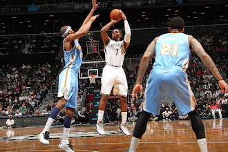 Photo: Joe Johnson #7 of the Brooklyn Nets takes a shot against the Denver Nuggets at the Barclays Center on February 13, 2013 in Brooklyn, NY.