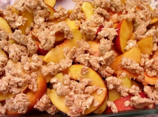 In a separate bowl, combine all the crumble ingredients (it should be crumbly in...
