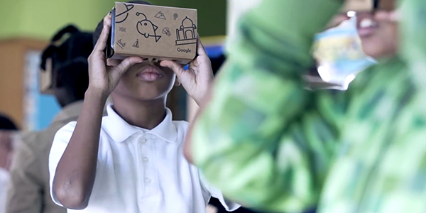 Students using Google Cardboard VR viewers
