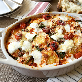 Baked Ravioli and Spinach with Charred Tomatoes.