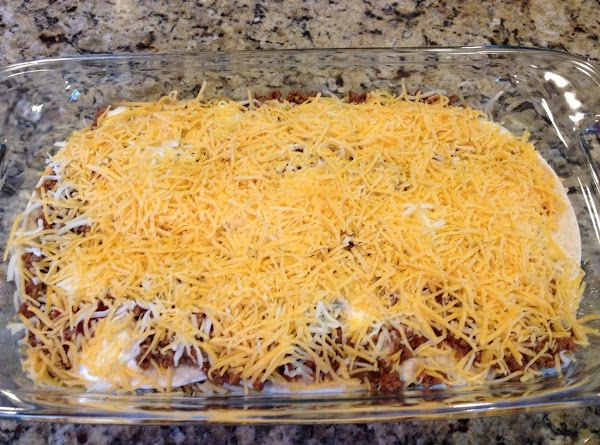 In a 2 qt rectangular or square baking dish, add a small amount of...