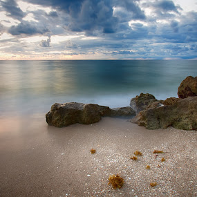 Calm before Sunrise by Tim Azar - Landscapes Beaches ( water, clouds, sand, deerfield beach, boulders, hdr, waves, tim azar, rocky, ocean, beach, neutral density, landscape, hdr efex pro 2, sun, sky, blue, florida, sunset, shoreline, cloudy, sunrise, rocks, slow shutter )