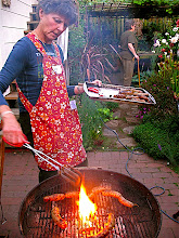 Photo: Sally grilling sour sausage 1