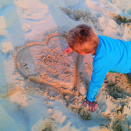 Drawing heart on a sand with love.. by Svetlana Saenkova - Instagram & Mobile Android ( sand, candids, child,  )