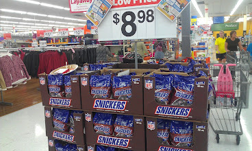 Photo: I thought about picking up some NFL Snickers Minis, but the kids don't need that much chocolate. My sister and her husband are both eating healthy and this is way too tempting...but these NFL displays are so much fun!