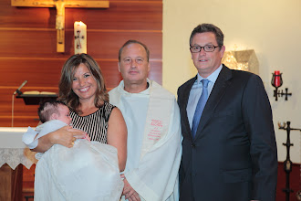 Photo: Baptism of Ana Corso on September 11, 2010. Fr. Ron with proud parents Elena and John (who were also married in OLM)
