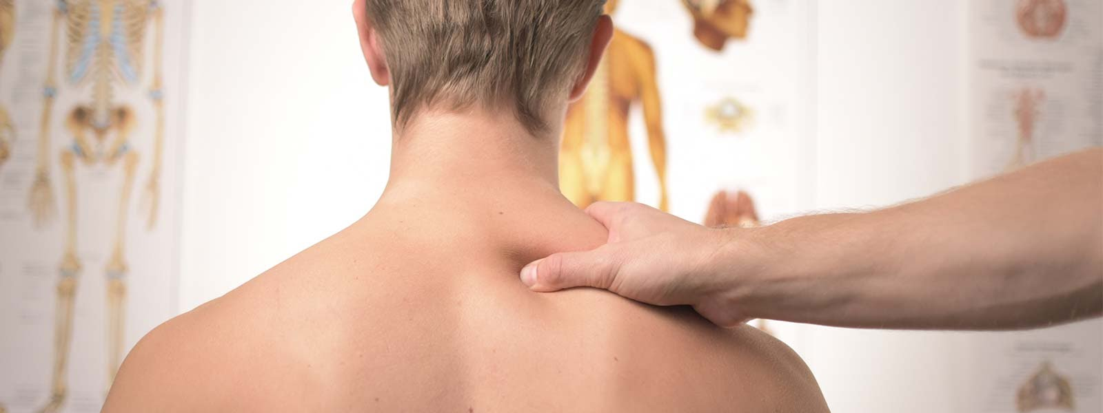 a man having his back checked by a chiropractor