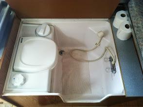 Photo: Tub with toilet, shower spray head