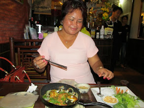 Photo: Neng enjoys a fish meal at a Hanoi restaurant