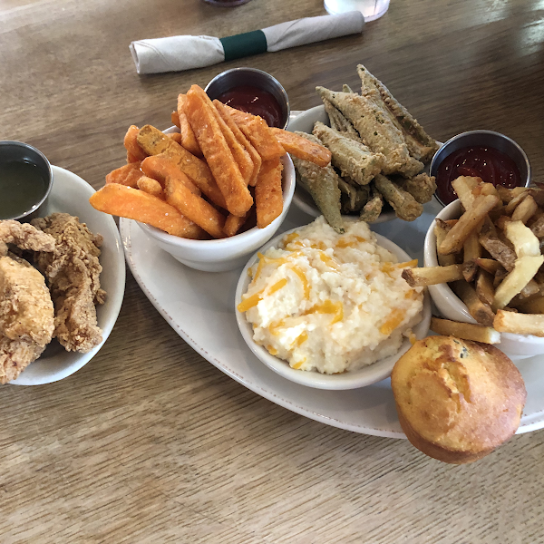 Fried okra, fried chicken fingers, sweet potato fries, house fries, jalapeño cornbread muffin and the best dang grits. It was all amazing but the chicken fingers and grits blew my mind. 5 stars!