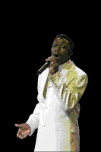 SW20040530VNH058:ENTERTAINMENT:MUSIC_EVENT:30MAY1980 - 20040530VNH: ENTERTAINMENT: Benjamin Dube performing during the 2004 MTN SAMA 10 awards held at SunCity on weekend. Pic: VELI NHLAPO. 30/052004. © Sowetan.