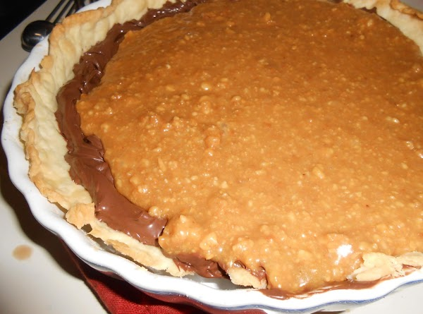 In a small saucepan, combine caramels and cream; cook over medium-low heat until blended,...