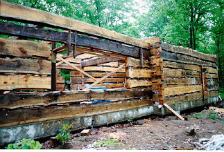 Photo: Here is the front view of the log work. Eventually there will be a deck here overlooking the lake.