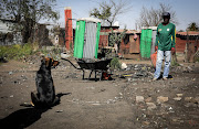 Residents of Kliptown are still forced to share a few portable toilets - or resort to the bucket system.