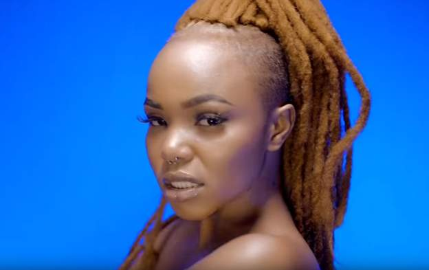 Image result for Tanzanian Govt bans rapper Rosa Ree over explicit music video with her Kenyan boyfriend Timmy Tdat
