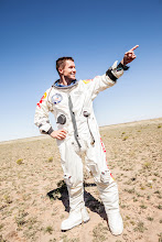 Photo: Pilot Felix Baumgartner of Austria celebrates after successfully completing the final manned flight for Red Bull Stratos in Roswell, New Mexico, USA on October 14, 2012. // balazsgardi.com/Red Bull Content Pool